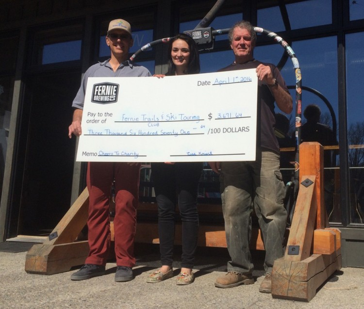 Dan Savage and Ian Stokie receive cheque from Courtnay Terriah of FBC